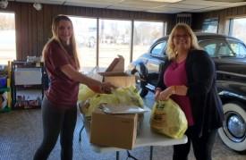 KayeLeigh and Donna packing backpacks